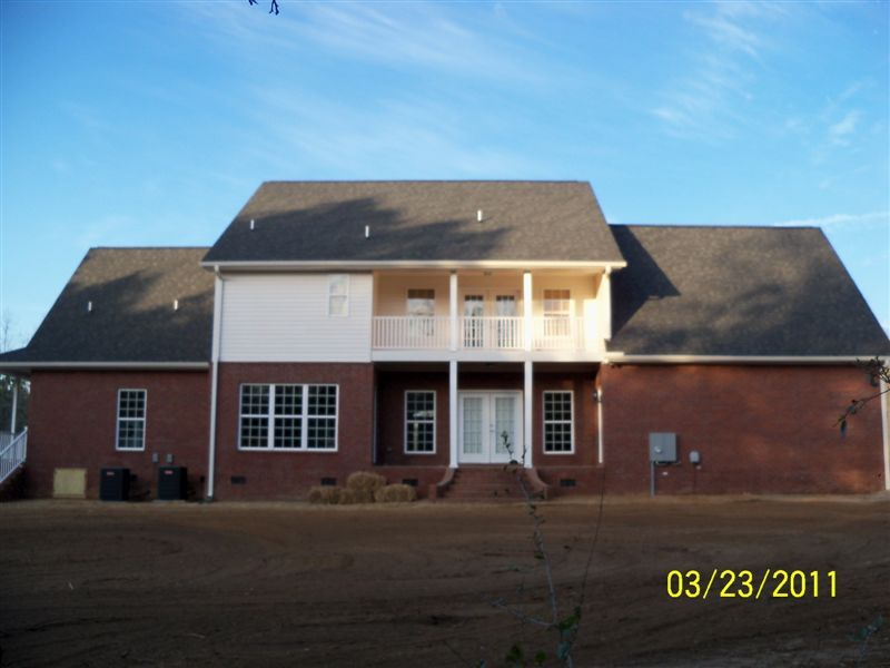 America 39 s home place rear view of custom hanover for Designer homes augusta ga