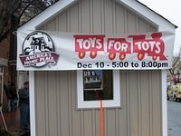 Custom Playhouse Auctioned Off at Our Toys for Tots Drive