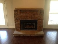 Stacked Stone Fireplace with Stone Mantle