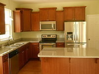 Staggered Cabinets with Stainless Steel Appliances