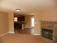 Family Room with Fireplace and Kitchen
