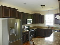 Completed Kitchen with Granite and Bronze Fixtures