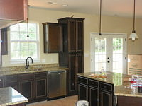 Glazed Cabinets with Granite Counter Tops and Stainless Appliances